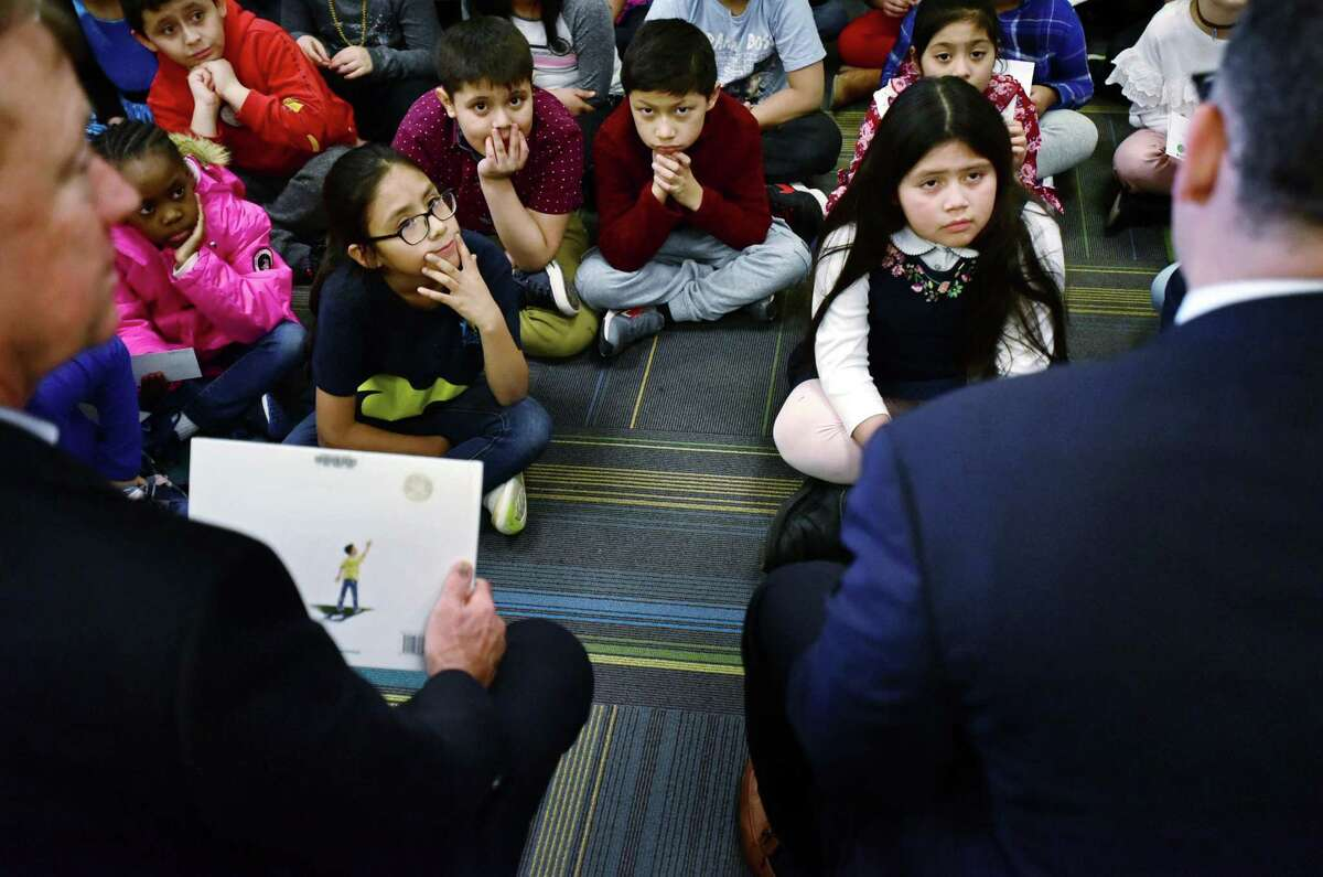 Silvermine Dual Language Magnet School students listen to State Department of Education Commissioner Miguel Cardona and Governor Ned Lamont speak in Norwalk in February.