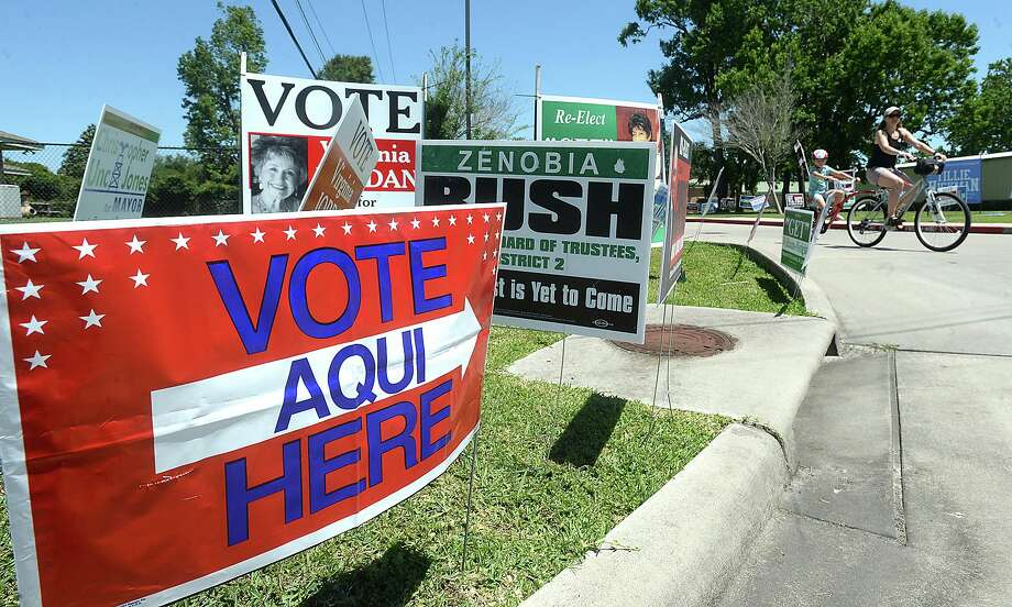 Signage fills the entrance to the BISD Administration Building, one of several polling sites open for voting Saturday. Voters cast their ballots on several positions, including Beaumont City Council and Mayor, as well as BISD board members. Photo taken Saturday, May 6, 2017 Kim Brent/The Enterprise Photo: Kim Brent / Beaumont Enterprise / BEN