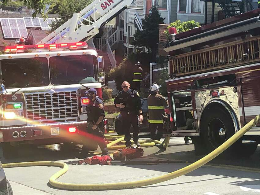 San Francisco firefighters rescued two people from a burning home in the 500 block of Lisbon Street on June 29, 2020.
