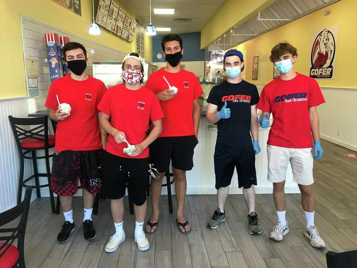 New Canaan High School's SLOBs members Will Galvan, Payton Welch, Christian Triay, Trey Donoghue and Gofer store manager Evan Beiles enjoy a Gofer ice cream after a Father's Day Car Wash fundraiser to help NC Moms raise money for the NCHS Scholarship Fund.
