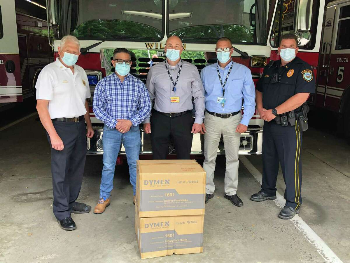 ASML in Wilton donated 4,000 face masks to the town's first responders on June 25. From left are Fire Chief Geoff Herald; ASML employees Bill Localzo, Brandon Marschner, and Chris Musante; and Police Lt. David Hartman.