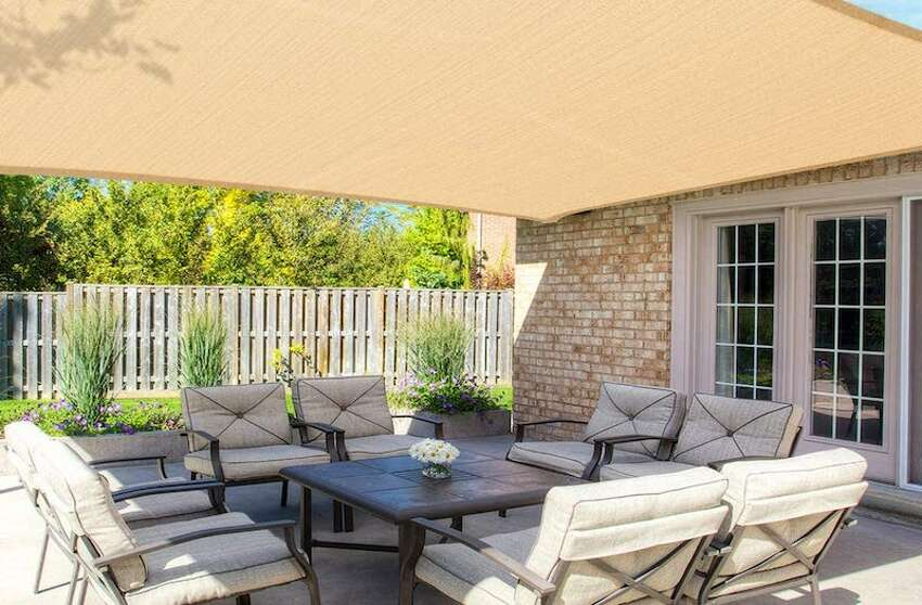 MOVTOTOP Sun Shade Sails 12x16 FT Rectangle Price: $55.99 For those who are looking for shade/coverage from the rain, but don't want an unsightly looking canopy in their yard, this MOVTOTOP Sun Shade Sails Rectangle is a good option. It covers 12 x 16 feet and comes with 4 stainless steel D-rings in the corners, and bonus with 4 x 6.6ft PE Ropes to hang for easy installation.