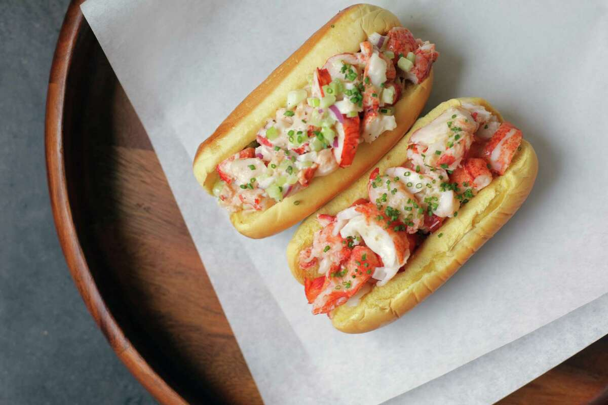 Lobster roll made with mayonnaise, left and lobster roll with brown butter by television food personality Andrew Zimmern.