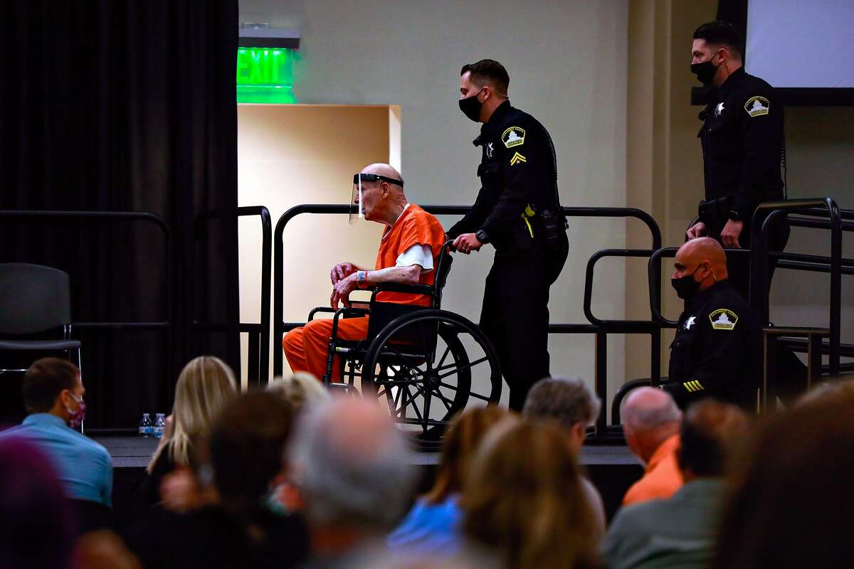 Joseph DeAngelo (center) is lead into court proceedings where he plead guilty for crimes linked to the Golden State Killer on June 29, 2020 in Sacramento.