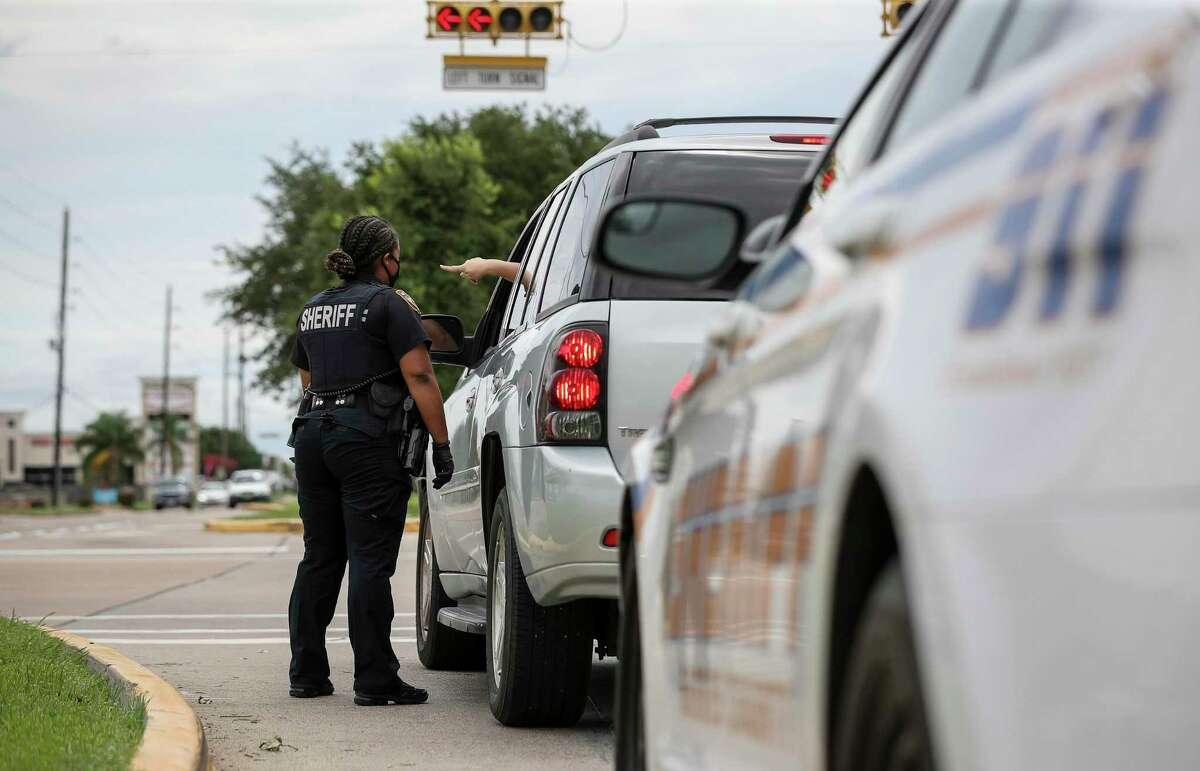 Harris County Sheriff's Deputy Nakeitha Dussette conducts a traffic stop Wednesday, June 24, 2020, near the intersection of Bellaire Boulevard and Metro Boulevard in Houston.