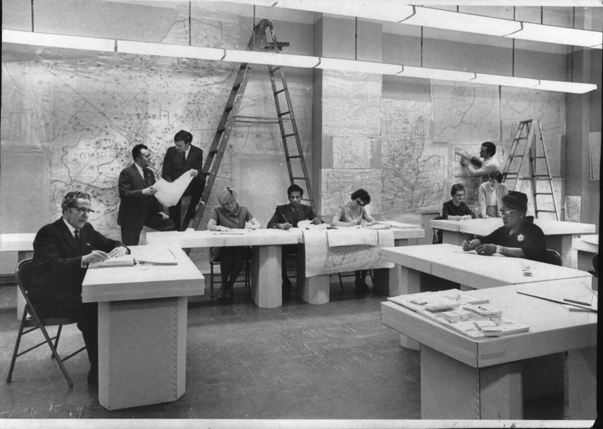 Census workers with maps in Albany, New York office. 1970 (Bob Richey/Times Union Archive)