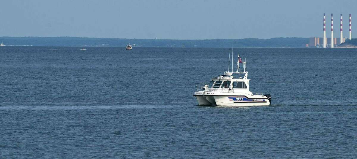 A Stamford Police Marine Division boat passes West Beach in Stamford, Conn., on Friday, August 8, 2014.