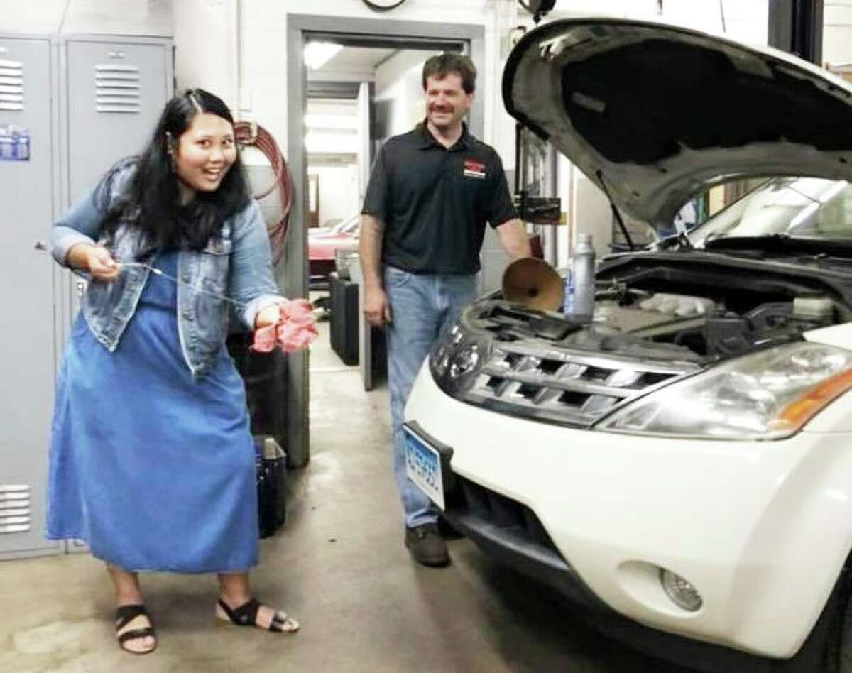 MOMS Club of Portland and Middletown is a group of local working and stay-at-home moms with children of all ages who offer one another support, resources and friendship. Here, onetime member Cristina Hayden attends a car care clinic for women at Hometown Garage in Portland.