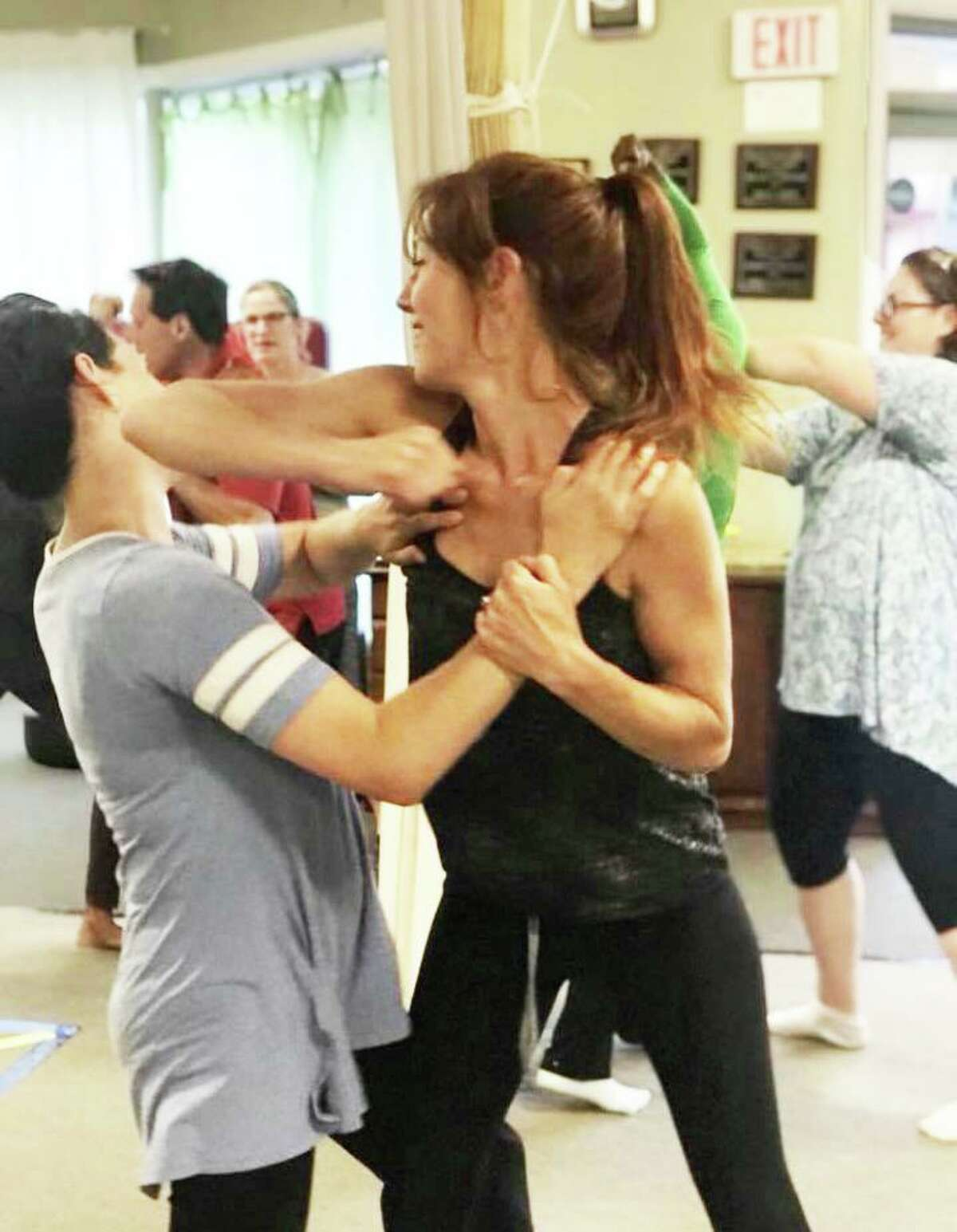 Former MOMS Club of Portland and Middletown members Laurel Steinhauser and Melissa Kelley learn self-defense techniques at Inner Circle Family Martial Arts in Portland.