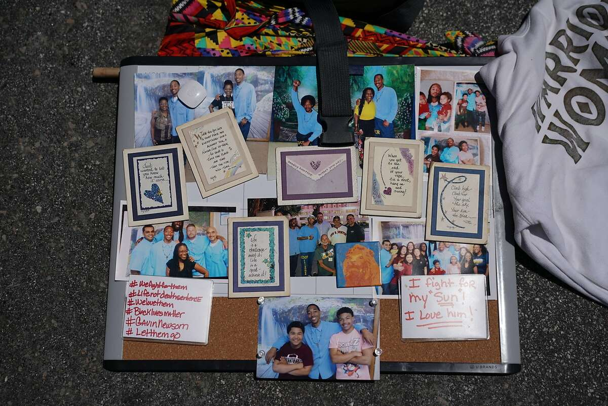 Shawanda Scott�s photos of her son incarcerated at San Quentin at the Stop San Quentin Outbreak rally at the prison gates on Sunday, June 28, 2020 in San Rafael, Calif. The group is concerned about he safety of the inmates being exposed to the coronavirus.