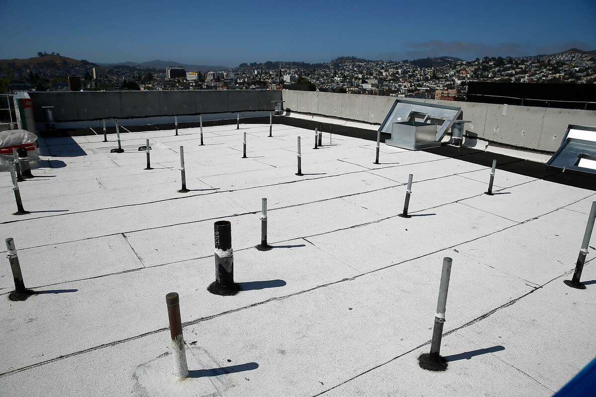 Stanchions are seen on the roof of Casa Adalante at 2060 Folsom Street and the San Francisco skyline beyond it on Monday, June 29, 2020 in San Francisco, Calif. The stanchions will support the solar panel grid for Casa Adalante after they are installed.
