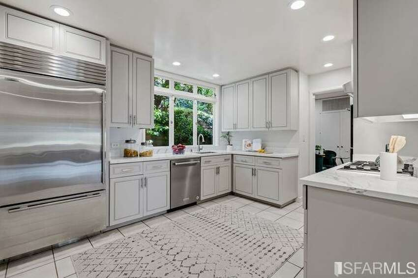 During their long-term ownership of the home, the Schusters updated the kitchen with Carrera marble counters and stainless steel appliances.
