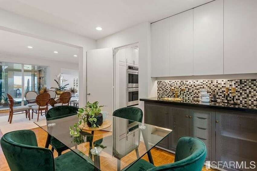 Off the kitchen is an informal eat-in area as well as a more formal dining room.