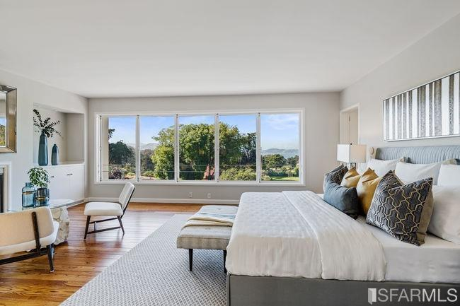 Upstairs, the master bedroom looks out over the Presidio all the way to the bay.