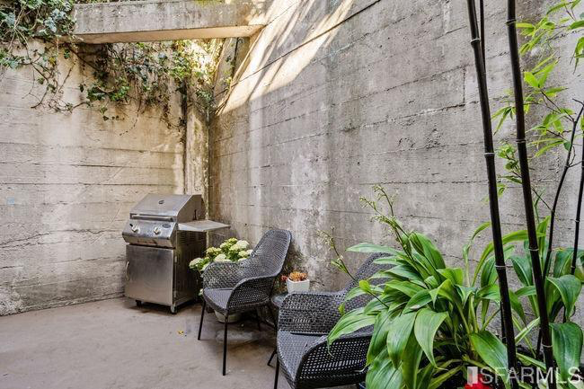 The informal eat-in area has sliding glass doors that lead out to the private patio.