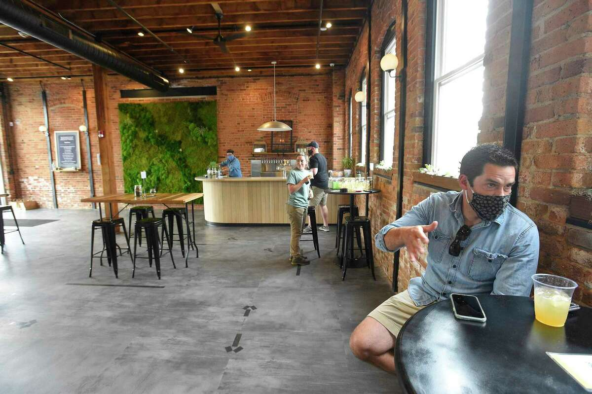 Half Full founder and Chief Hoptimist Conor Horrigan makes a point during an interview Half Full's new gathering place, Third Place, at 575 Pacific St., in Stamford, Conn., on June 25, 2020