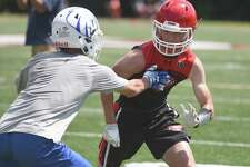 New Canaan's Maddox Underwood goes against a Newington defender during the annual Grip It and Rip It football tournament in New Canaan on Friday, July 12, 2019.