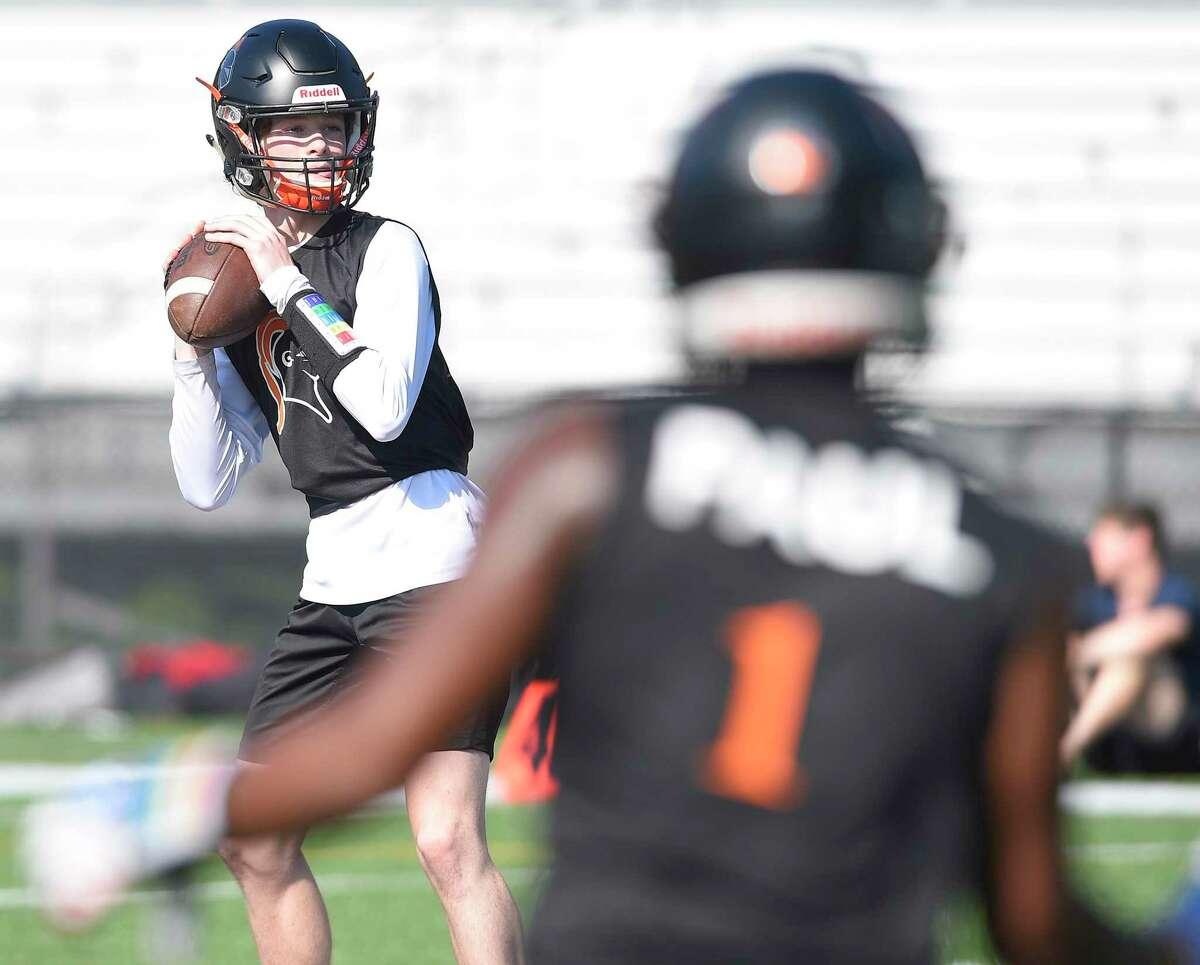 Greenwich quarterback James Rinello (7) drops back for a pass against Darien in the first half in a CIAC Class LL football quarterfinal at Darien High School in Darien on Dec. 4.