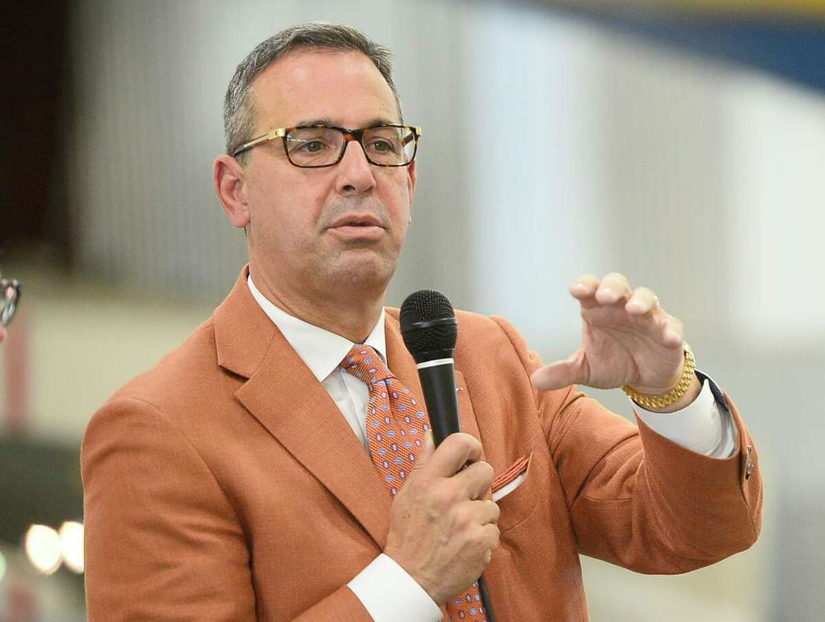 """Texas athletics director Chris Del Conte said the Longhorns """"fully expected that we'd have some COVID-19 cases, and fortunately, most of the student-athletes are experiencing mild or no symptoms, and none have required hospitalization,"""""""