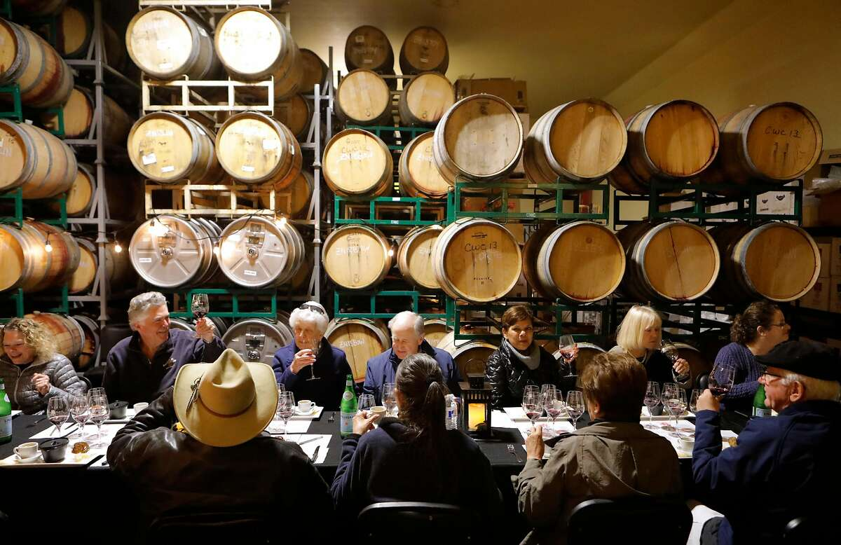 Visitors enjoy a food and wine pairing at the Scott Harvey Winery in Plymouth, Ca., on Sat. Feb. 16, 2019.