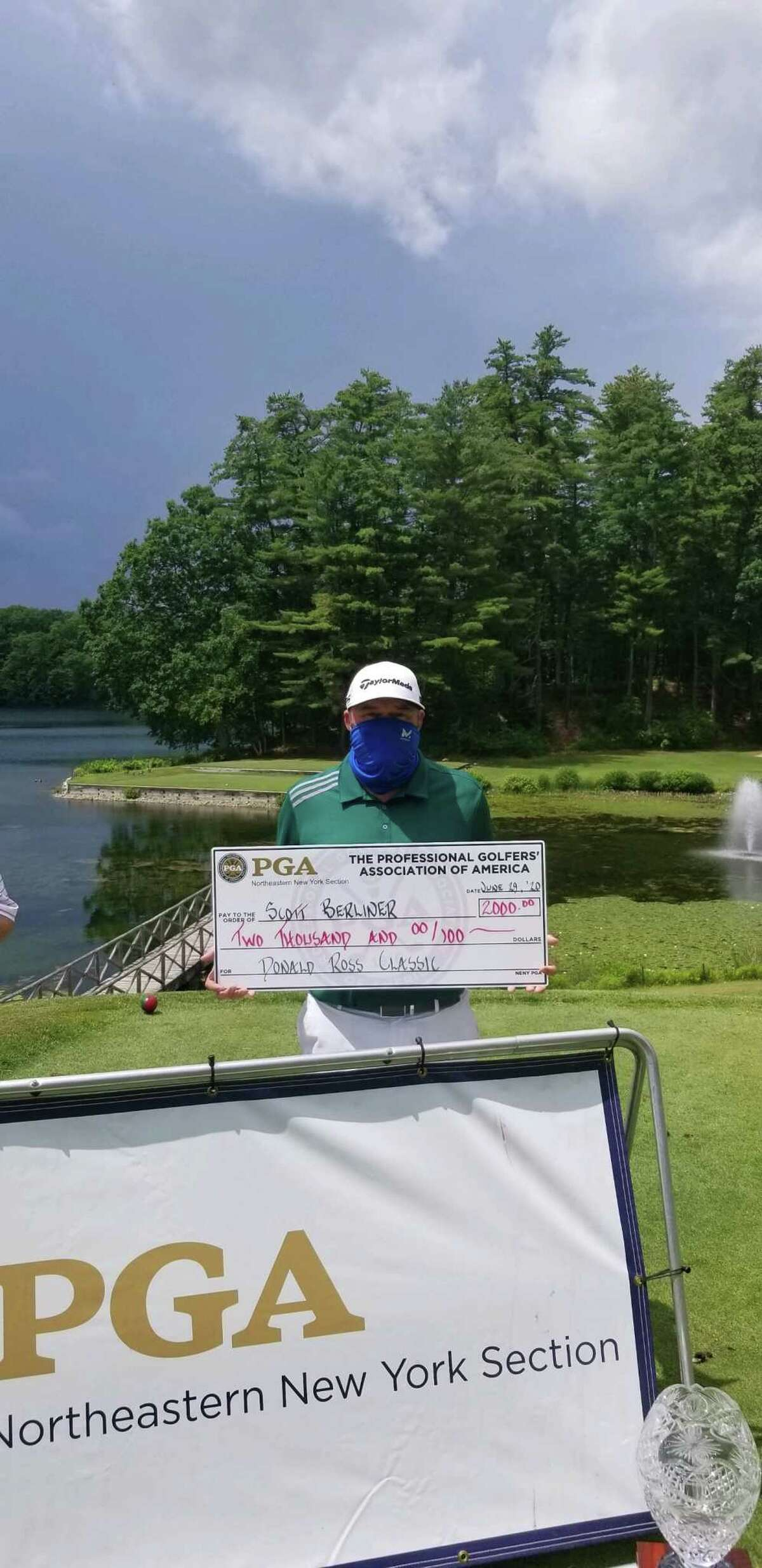 Scott Berliner displays the check for winning the Donald Ross Classic at Glens Falls Country Club on Monday, June 29, 2020.