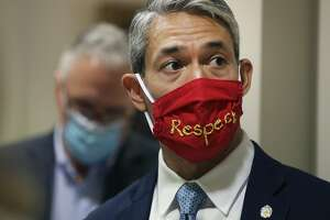 Mayor Ron Nirenberg wears a mask with the word, respect, on it as San Antonio City Council gets its first look at next year's budget on Thursday, June 18, 2020. The city faces a massive budget shortfall of $200 million because of the Coronavirus pandemic. Budget officials are looking at deeper cuts in next year's budget.