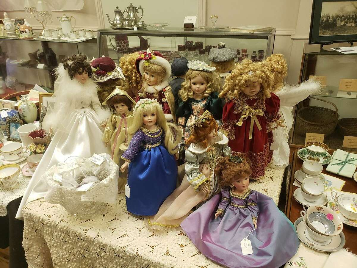 Dolls for sale throughout the Academy Museum & Antique Shop in Orange.