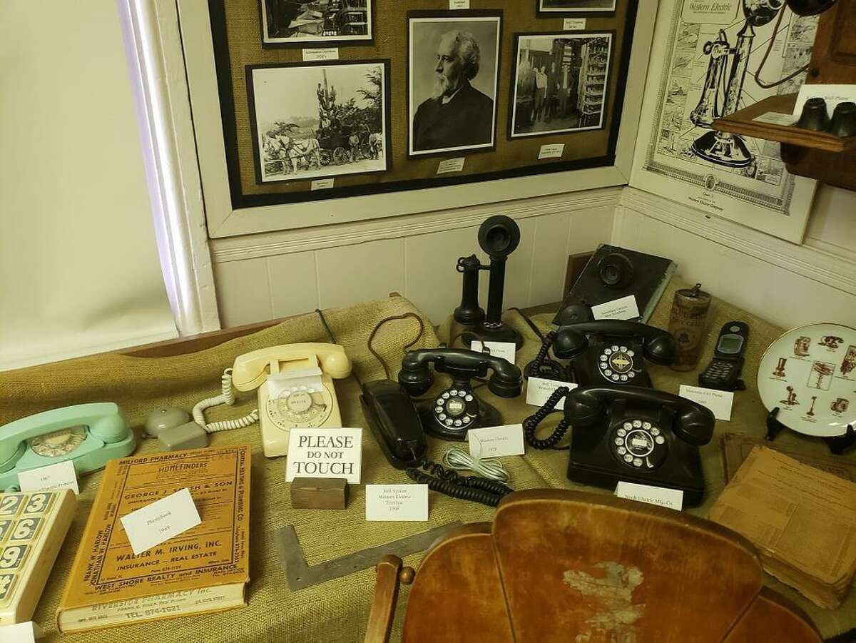 A display of old phones on exhibit at the Orange Historical Society's Academy Museum & Antique Shop.