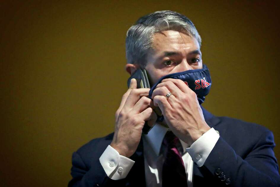 Mayor Ron Nirenberg adjusts his mask as he takes a phone call. The mayor, City Council and city officials met at Henry B. Gonzalez Convention Center to go over issues pertaining to the budget , on Friday, June, 26, 2020.