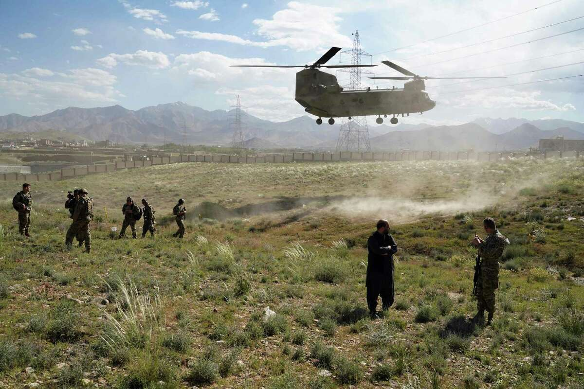 In this file photo taken on June 6, 2019 a U.S. military helicopter lands on a field outside the governor's palace during a visit by the commander of U.S. and NATO forces in Afghanistan, General Scott Miller, and Asadullah Khalid, acting minister of defense of Afghanistan, in Maidan Shar, capital of Wardak province. President Donald Trump denied on June 28, 2020, being briefed on intelligence that reportedly showed Russia had offered bounties to Taliban-linked militants for killing U.S. soldiers in Afghanistan. (Photo by THOMAS WATKINS/AFP via Getty Images)