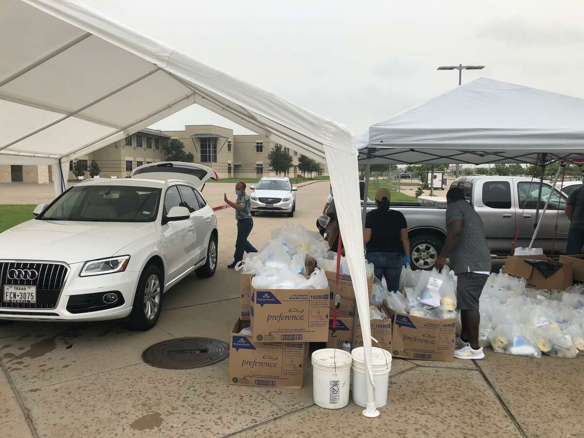 State Rep. Gary Gates and his team hand out kits of personal protective equipment, hand sanitizer and toilet paper to area residents at Tompkins High School in Katy on Friday, June 26, 2020.