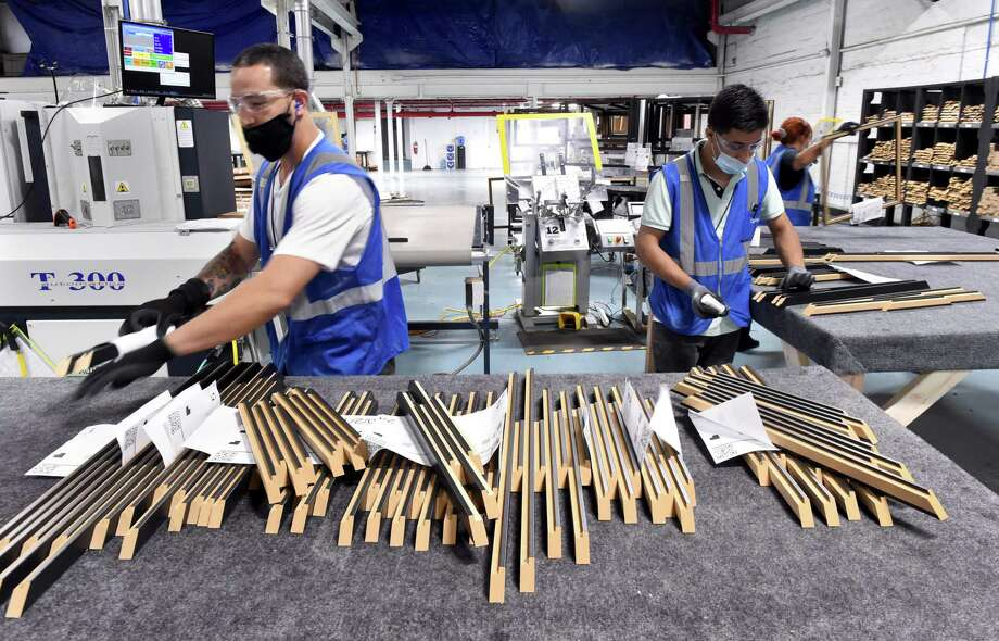 Components for custom frames are made at the newly opened Art To Frames factory in the Fair Haven section of New Haven on June 29, 2020. Photo: Arnold Gold / Hearst Connecticut Media / New Haven Register