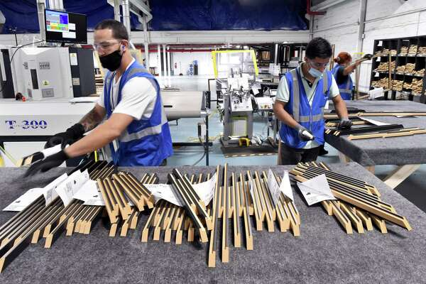 Components for custom frames are made at the newly opened Art To Frames factory in the Fair Haven section of New Haven on June 29, 2020.