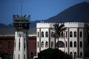 An exterior view of San Quentin State Prison on June 29, 2020 in San Quentin, California. San Quentin State Prison is continuing to experience an outbreak of coronavirus COVID-19 cases with over 1,000 confirmed cases amongst the staff and inmate population. San Quentin had zero cases of COVID-19 prior to a May 30th transfer of 121 inmates from a Southern California facility that had hundreds of active cases 13 COVID-19-related deaths.
