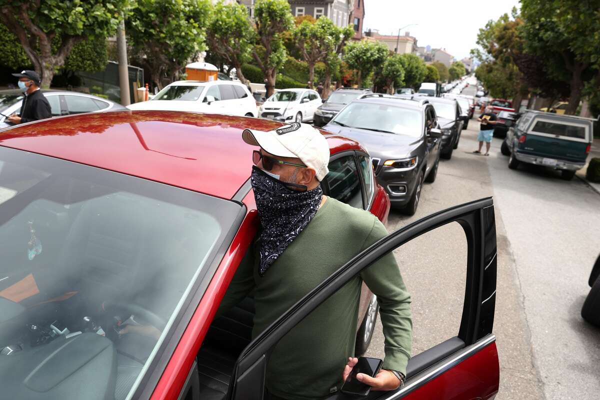 Alex, an app-based driver, honks his horn during a demonstration in front of the home of Uber CEO Dara Khosrowshahi on June 24, 2020 in San Francisco, California. Dozens of app-based workers held a caravan style protest outside of the home of Uber CEO Dara Khosrowshahi to denounce companies that are classifying workers as independent contractors and have not supplied workers with proper personal protective equipment (PPE) during the coronavirus COVID-19 pandemic.