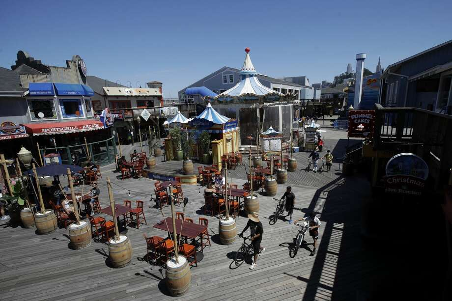 People visit Pier 39 during the coronavirus outbreak in San Francisco, Thursday, June 18, 2020. Photo: Jeff Chiu/Associated Press / Copyright 2020 The Associated Press. All rights reserved