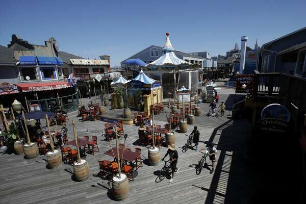 People visit Pier 39 during the coronavirus outbreak in San Francisco, Thursday, June 18, 2020.