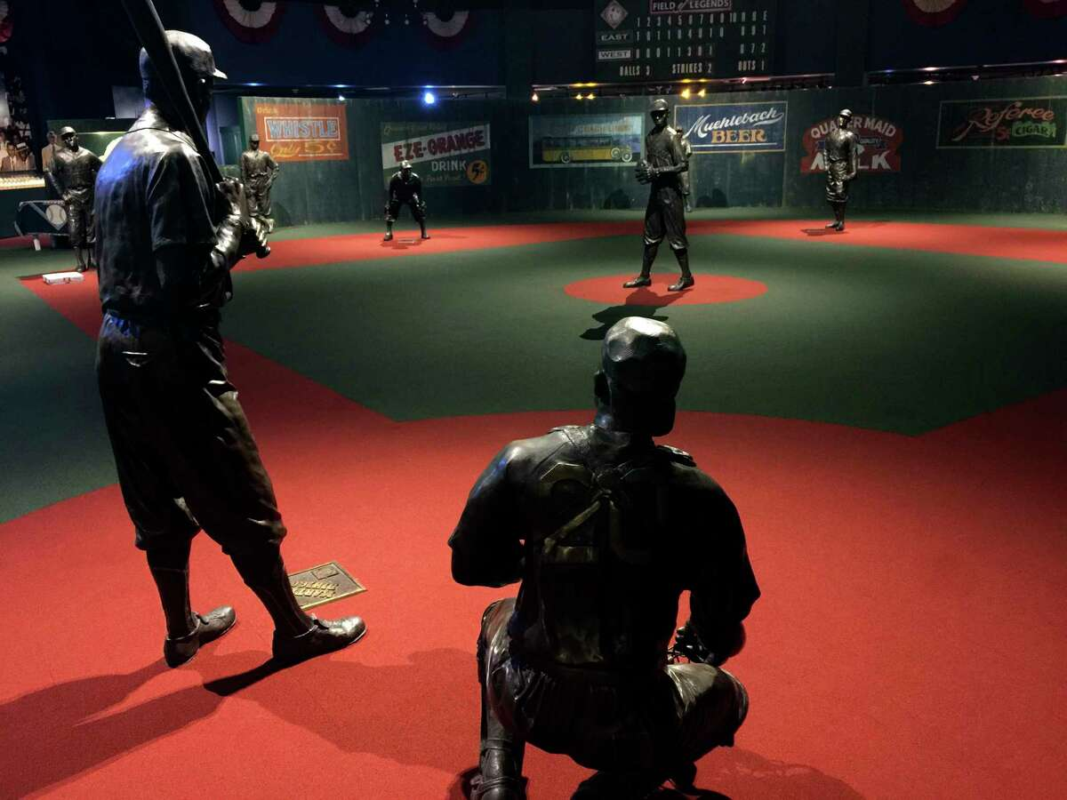 In this undated photo provided by the Negro Leagues Baseball Museum, the Field of Legends at the Negro Leagues Baseball Museum is viewed in Kansas City, Mo. The display features 10 life-size statues of Negro League greats cast in position as if they were playing a game. Former President Barack Obama tipped his cap. So did three other former presidents and a host of prominent civil rights leaders, entertainers and sports legends in a virtual salute to the 100-year anniversary of the founding of baseballa€™s Negro Leagues. The campaign launched Monday, June 29, 2020, with photos and videos from, among others, Hank Aaron, Rachel Robinson Derek Jeter, Colin Powell, Michael Jordan, Obama and presidents George W. Bush, Bill Clinton and Jimmy Carter at tippingyourcap.com. (Negro Leagues Baseball Museum via AP)