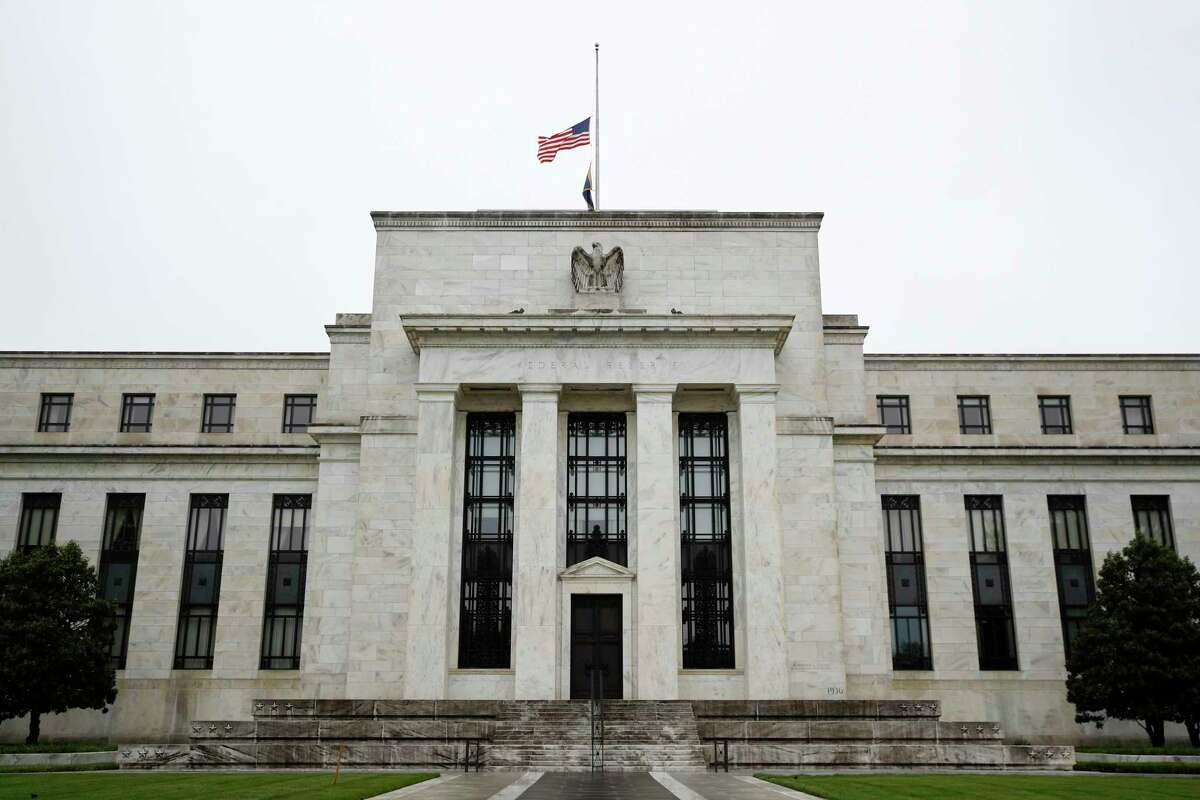 FILE - In this May 22, 2020, file photo, the Federal Reserve building is viewed in Washington. The Federal Reserve's Main Street lending program is off to a slow start. Banks are showing a surprising lack of interest in the program, while businesses are having a hard time accessing it. (AP Photo/Patrick Semansky, File)