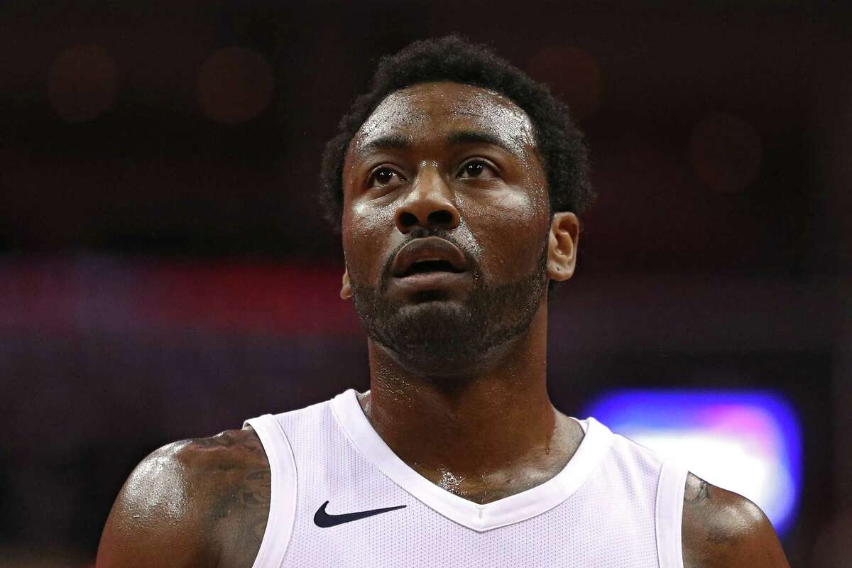 WASHINGTON, DC - APRIL 27: John Wall #2 of the Washington Wizards looks on against the Toronto Raptors in the first half during Game Six of Round One of the 2018 NBA Playoffs at Capital One Arena on April 27, 2018 in Washington, DC. NOTE TO USER: User expressly acknowledges and agrees that, by downloading and or using this photograph, User is consenting to the terms and conditions of the Getty Images License Agreement. (Photo by Patrick Smith/Getty Images)