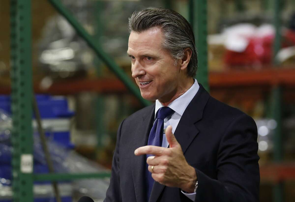 Gov. Gavin Newsom gives an update in Rancho Cordova, Calif., Friday, June 26, 2020, on the state's response to the coronavirus pandemic. Newsom said he wants Imperial County in Southern California to reimpose a stay-at-home order amid a surge in positive coronavirus tests. He also said he expects more counties to consider slowing or rollin back on reopening if necessary. (AP Photo/Rich Pedroncelli, Pool)