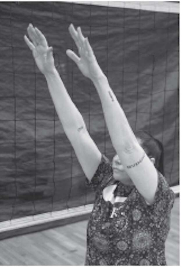 Lindsey Berg tips for volleyball setters. Follow through with a Superman flying motion. Photo: SportStars Magazine