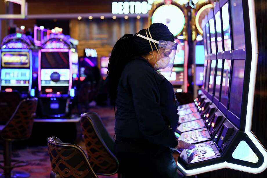 Mariam Hashimi wears a mask and face shield as she plays a slot machine at MGM National Harbor in Maryland on Monday, June 29, 2020. Photo: Washington Post Photo By Matt McClain / The Washington Post