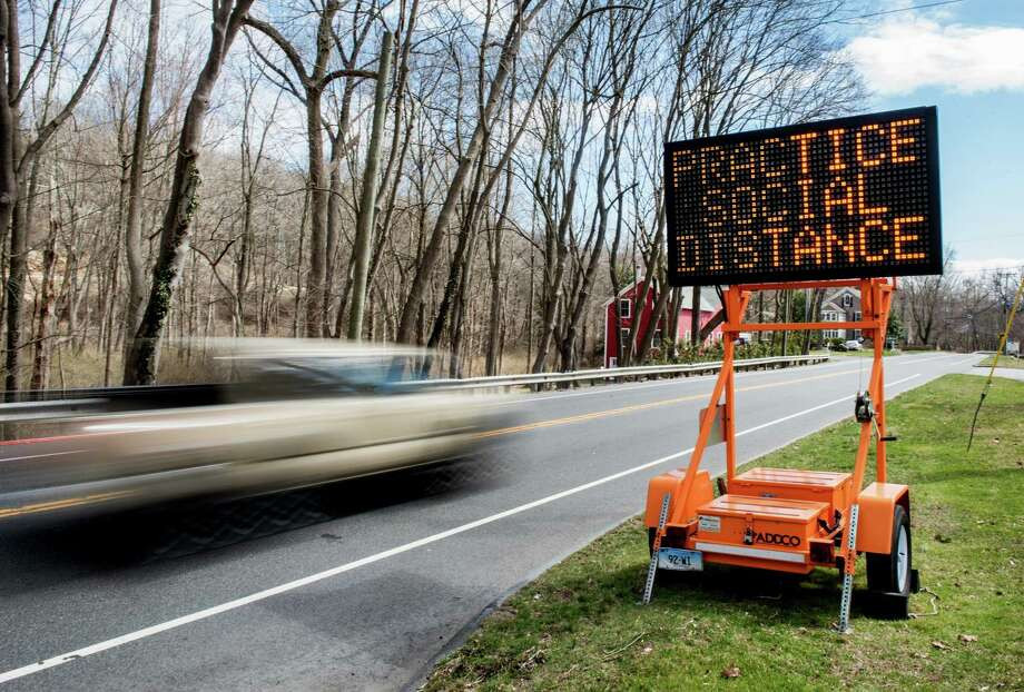 """Earlier this year, a sign reminded people to """"keep their distance"""" and stay safe from coming down with COVID-19. Cases are gradually creeping back up, with four new cases reported as of Oct. 1. Photo: Bryan Haeffele / Hearst Connecticut Media / BryanHaeffele"""