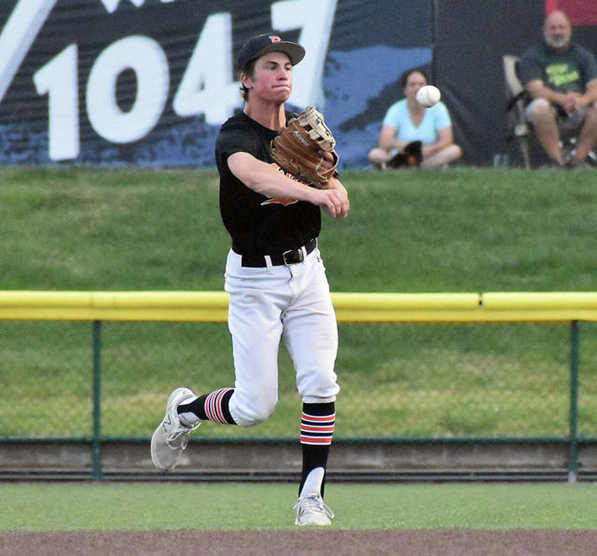Edwardsville second baseman Evan Funkhouser fires a throw to first base for a force-out.