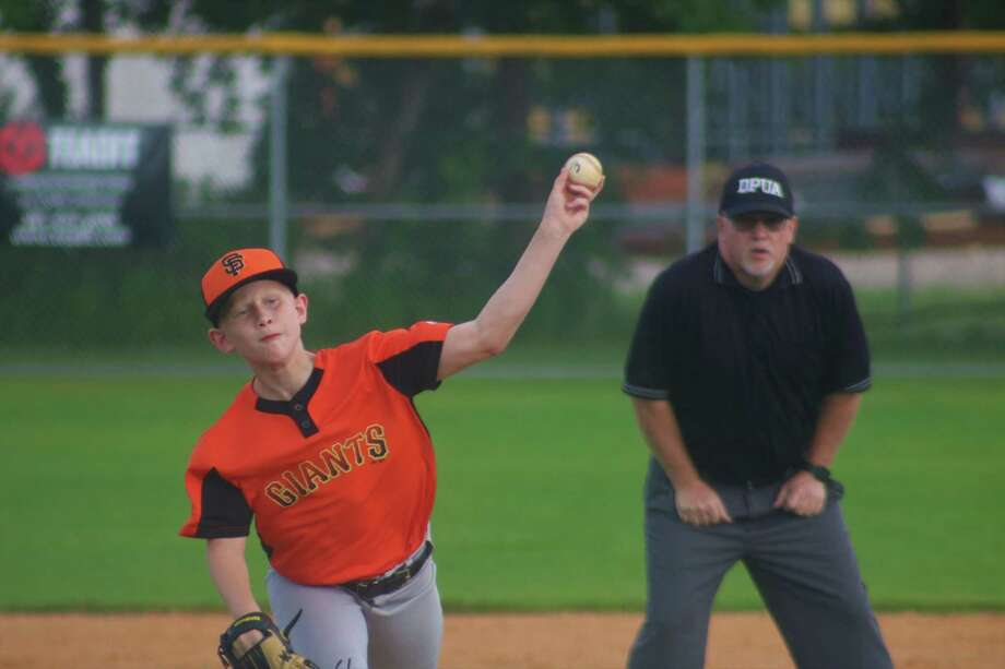 Ethan Flynn works on another Athletics batter Monday night as he helped the Giants begin a busy week with a victory. Photo: Robert Avery