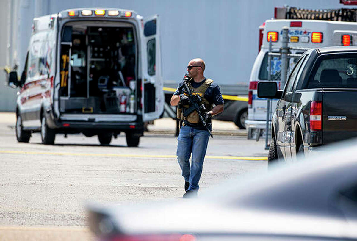 Law enforcement officers respond Friday to an active shooter at the Bunn-O-Matic warehouse in Springfield.