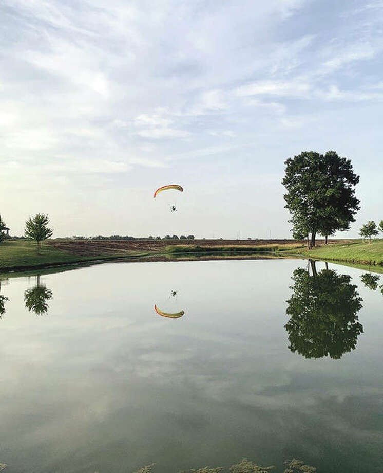 Reggie Toler pilots a powered parachute over his farm near Franklin. Toler is a certified flight instructor for powered parachutes.