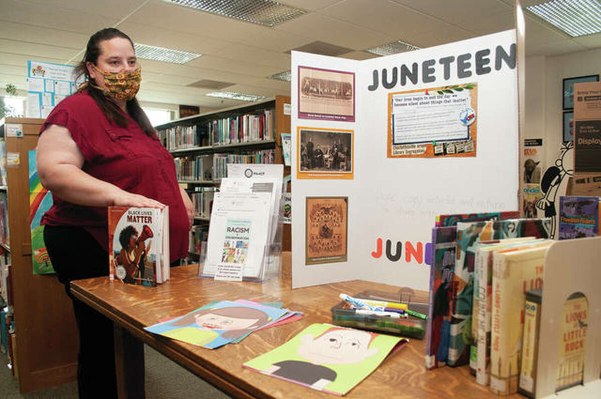 Cindy Boehlke, youth services director for Jacksonville Public Library, talks about the display that is up for children - and adults - to teach about Juneteenth, systemic racism, the Black Lives Matter movement, protesting and civil rights. The exhibit will be up until July 11. The goal is to help parents talk about racism with their children.