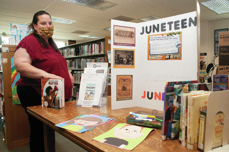Cindy Boehlke, youth services director for Jacksonville Public Library, talks about the display that is up for children — and adults — to teach about Juneteenth, systemic racism, the Black Lives Matter movement, protesting and civil rights. The exhibit will be up until July 11. The goal is to help parents talk about racism with their children. Photo: Darren Iozia | Journal-Courier